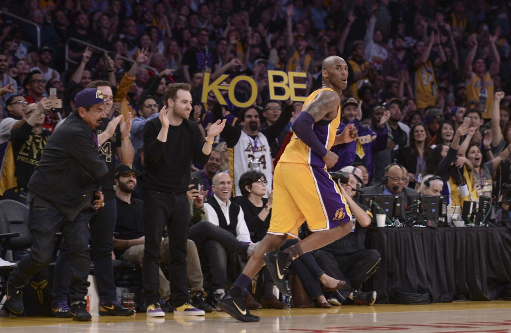 Apr 13, 2016; Los Angeles, CA, USA; Fans cheer after Los Angeles Lakers forward Kobe Bryant (24) hits a jump shot during the third quarter against the Utah Jazz at Staples Center. Bryant was playing in the final game of his NBA career. Mandatory Credit: Robert Hanashiro-USA TODAY Sports