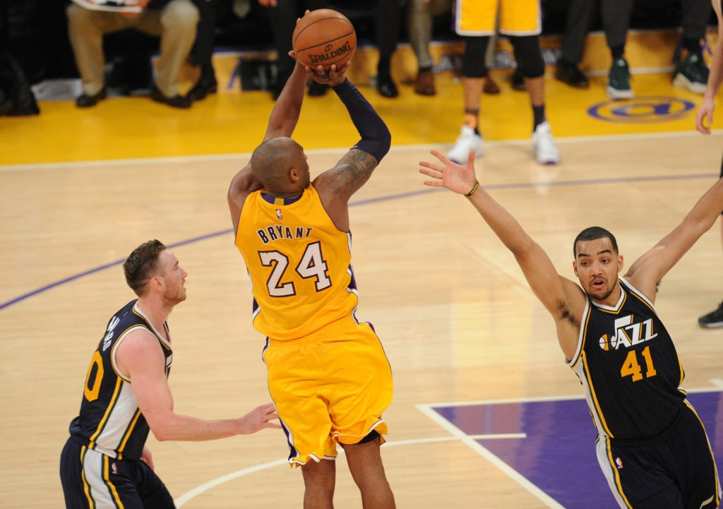 April 13, 2016; Los Angeles, CA, USA; Los Angeles Lakers  forward Kobe Bryant (24) shoots against Utah Jazz forward Trey Lyles (41) during the second half at Staples Center. Mandatory Credit: Gary A. Vasquez-USA TODAY Sports