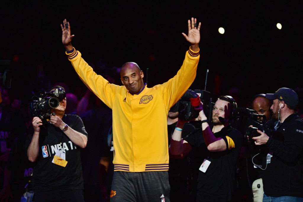 Apr 13, 2016; Los Angeles, CA, USA; Los Angeles Lakers forward Kobe Bryant (24) waves to the crowd as he walks on the court before a game against the Utah Jazz at Staples Center. Bryant concludes his 20-year NBA career tonight. Mandatory Credit: Robert Hanashiro-USA TODAY Sports